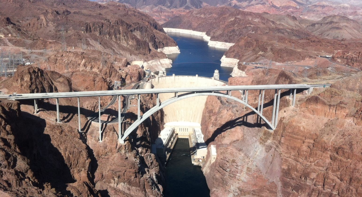 The Hoover Dam and the surrounding scenery seen from above on a helicopter tour.