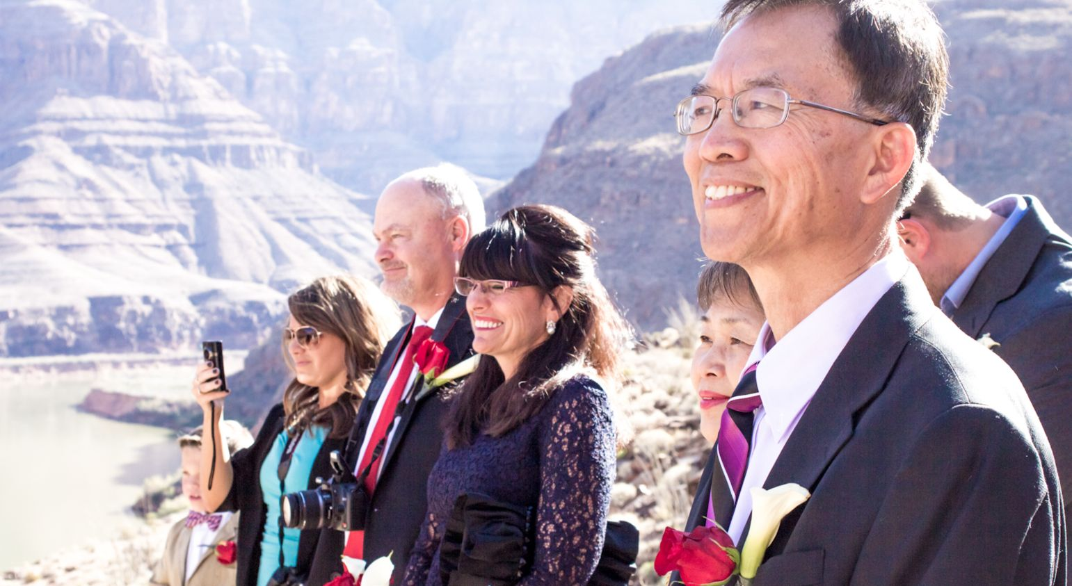 Several spectators at a Grand Canyon wedding.