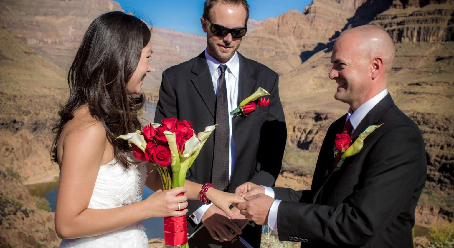 A bride and groom get married on the floor of the Grand Canyon West Rim.