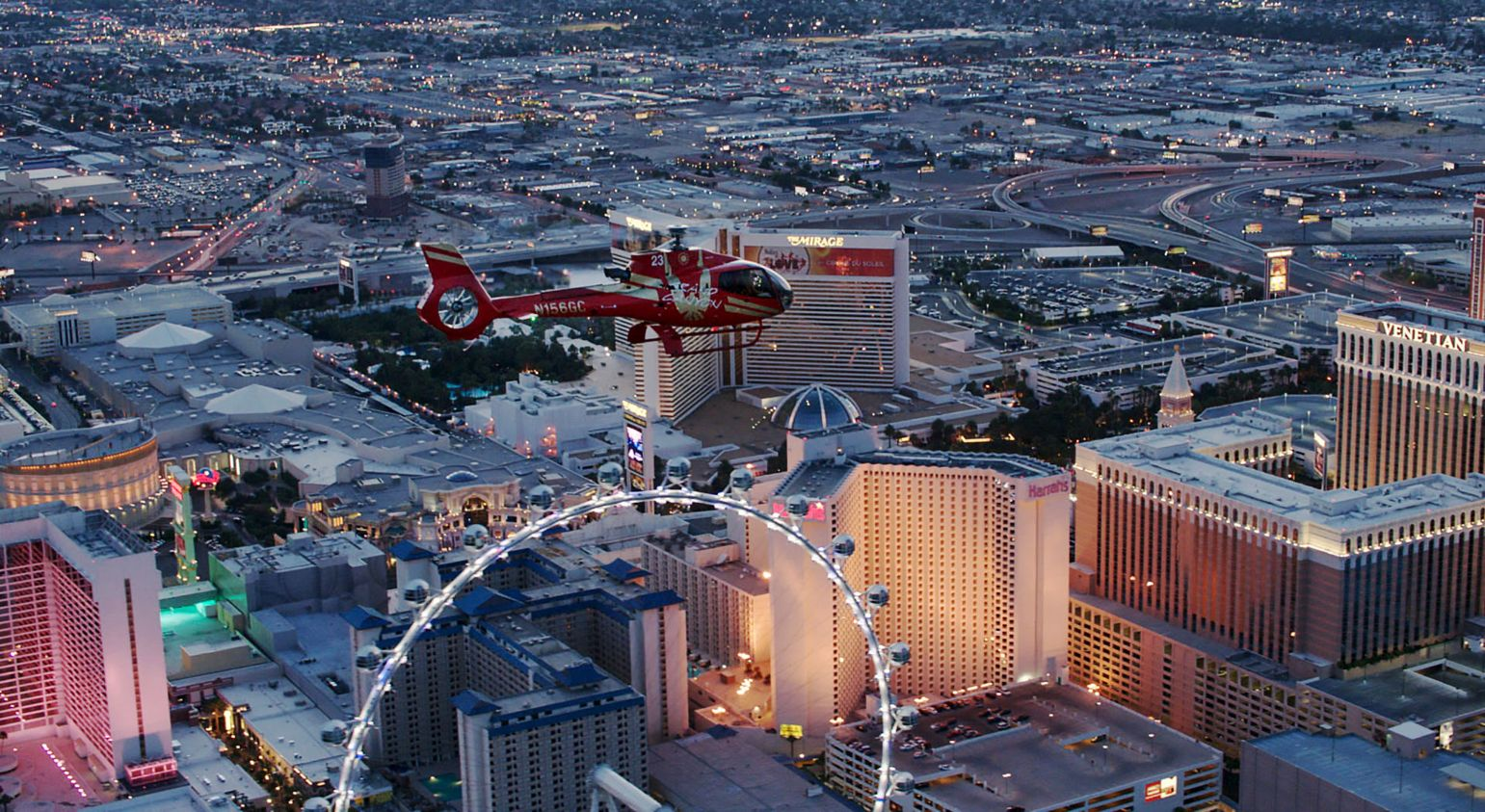 Helicopter flying past the LINQ hotel on the Las Vegas Strip.