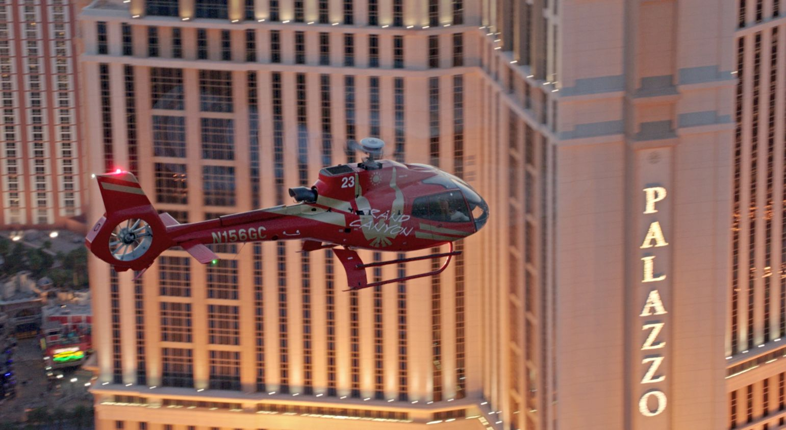 Helicopter flying past the Palazzo Hotel on Las Vegas Strip.