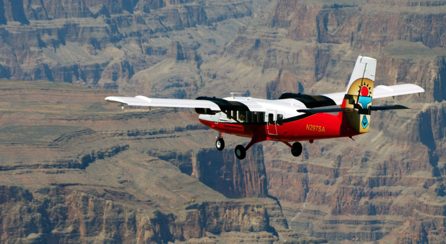 A small airplane flies on a Grand Canyon tour.