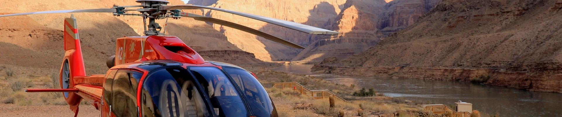 Helicopter landing at the bottom of the Grand Canyon West Rim during Grand Voyager Tour