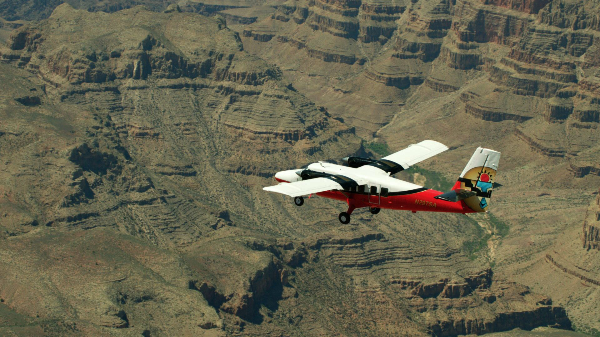 An airplane soaring high above the Grand Canyon