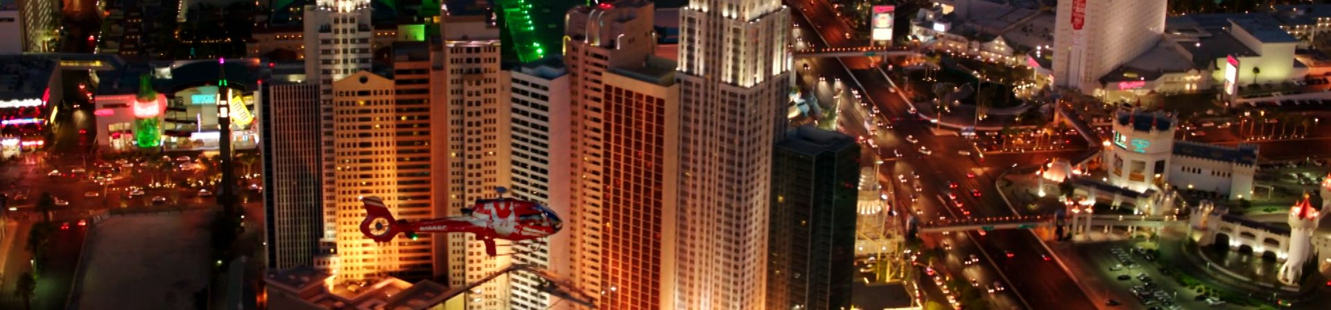 Helicopter flying past New York New York Hotel on Las Vegas Strip.