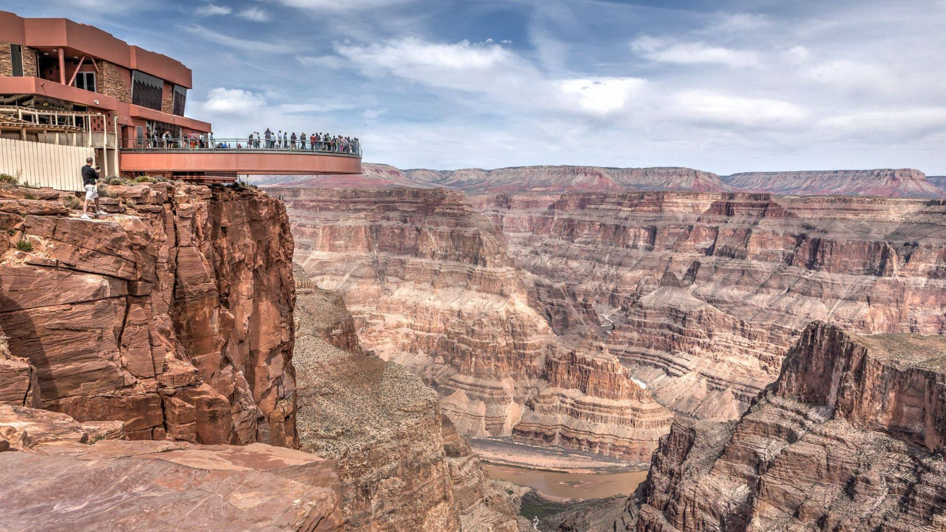 People on the Skywalk over the vast landscape of the Grand Canyon's west rim
