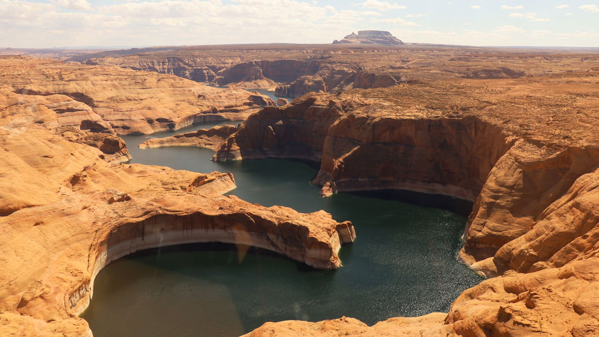 Redrock cliffs of Navajo Canyon on Lake Powell looking east