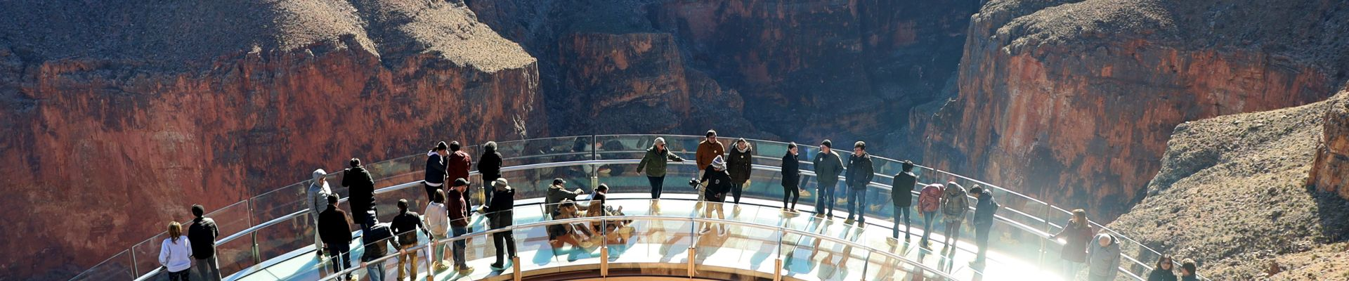Guests standing on the Grand Canyon Skywalk at Grand Canyon West