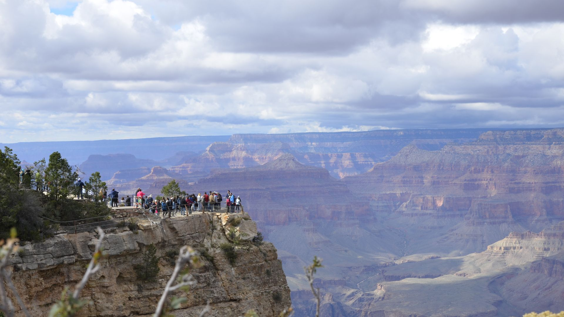 People standing on rim of Grand Canyon