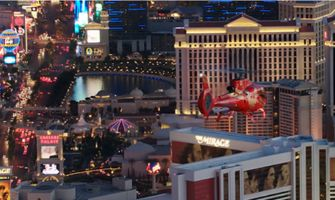 Red helicopter flying over the Las Vegas Stip