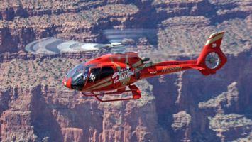 Red EC-130 in flight