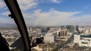 Las Vegas strip visible through the helicopter windows