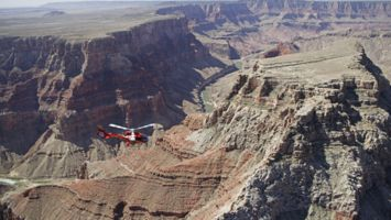 Red EC-130 flying over the Grand Canyon