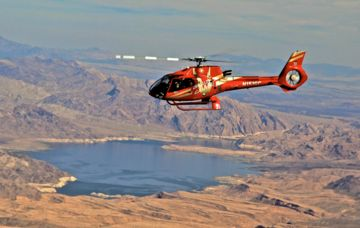 A Papillon Grand Canyon Helicopters flying over the western end of Grand Canyon