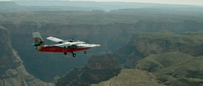 An airplane flies over the West Rim on a Grand Canyon tour.