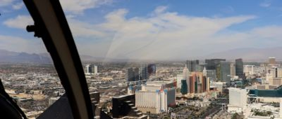 The Las Vegas Strip seen from above through the front window of a helicopter tour.