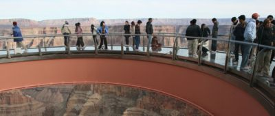 Visitors to the Grand Canyon West standing atop the Skywalk Bridge.