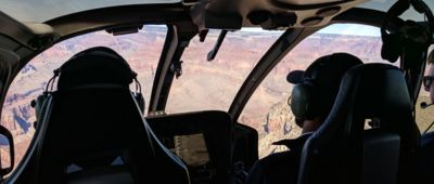 The Grand Canyon National Park visible through the windshield inside a helicopter tour.