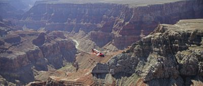 A Grand Canyon helicopter tour  flies above the national park, seen from an aerial view.
