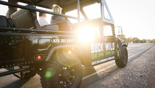 The sun shining through the window of a customized Buck Wild Hummer.