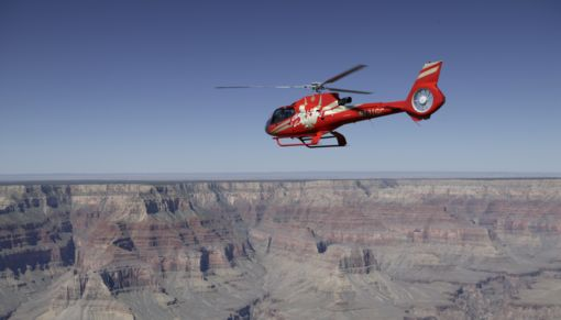 Red helicopter at the bottom of the Grand Canyon West Rim