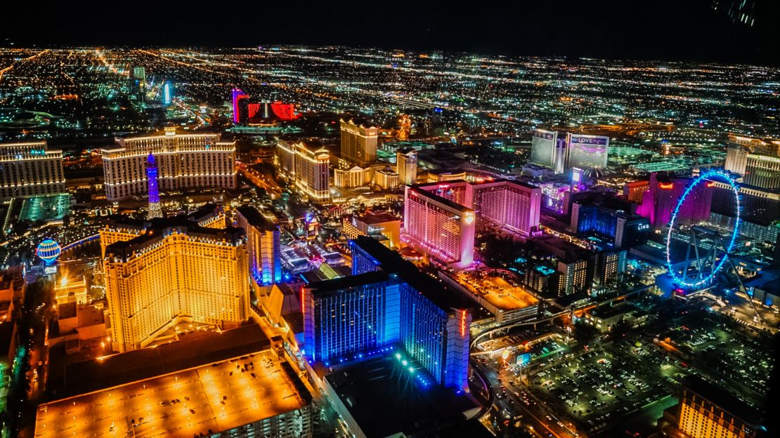 Views of Las Vegas Strip lights at night time from helicopter.