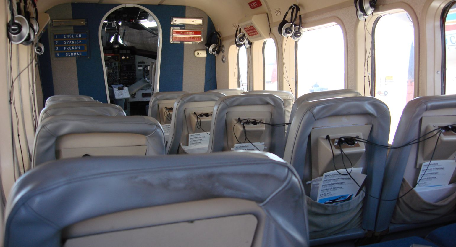 Interior shot of an twin otter with seating in 2 seat and single seat arrangements.