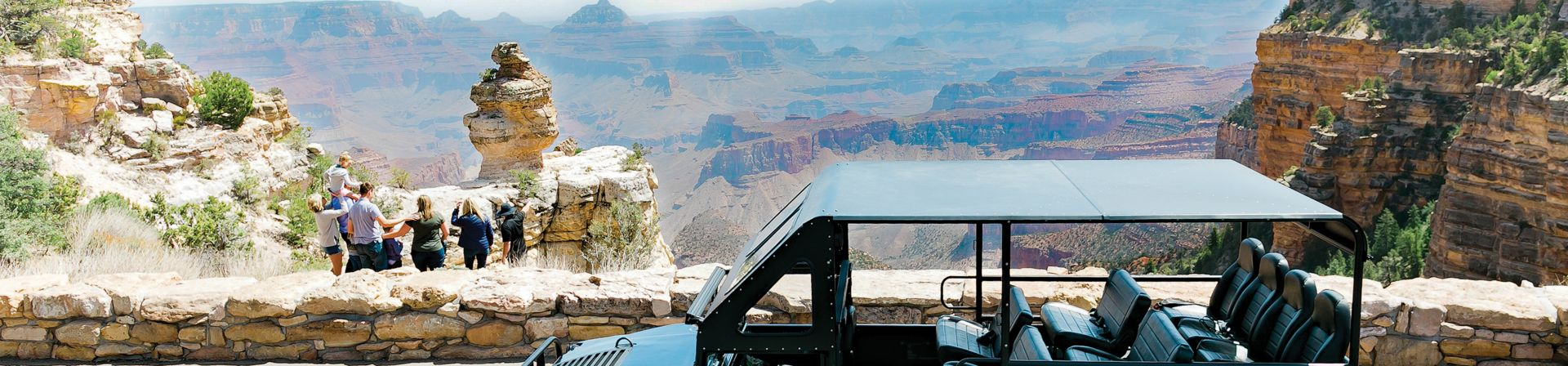 Guests overlooking the Grand Canyon at one of the stops on The Signature Tour