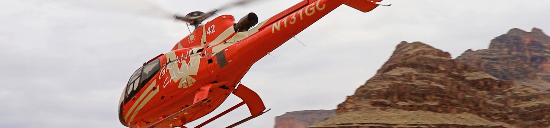 A helicopter provides transportation from the rim at Grand Canyon West down to the riverside boat dock.