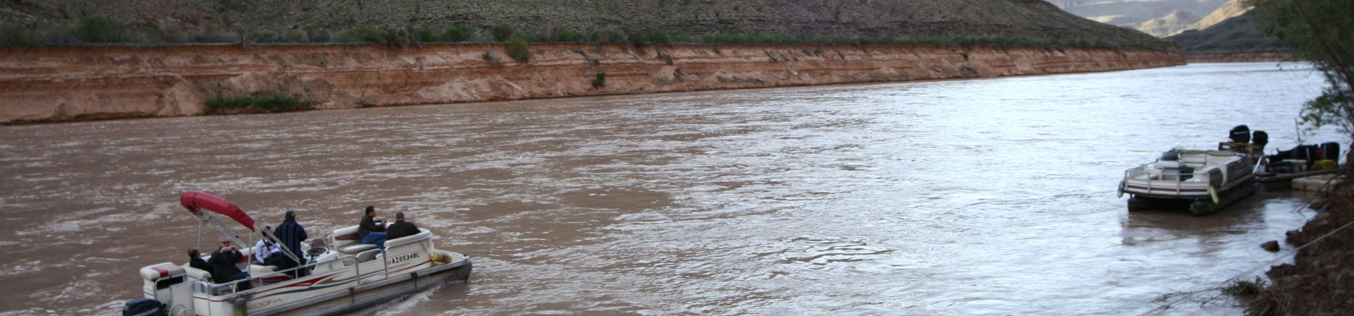 A pair of boats on the west end of the Colorado River, part of the Grand Canyon Helicopter landing tour