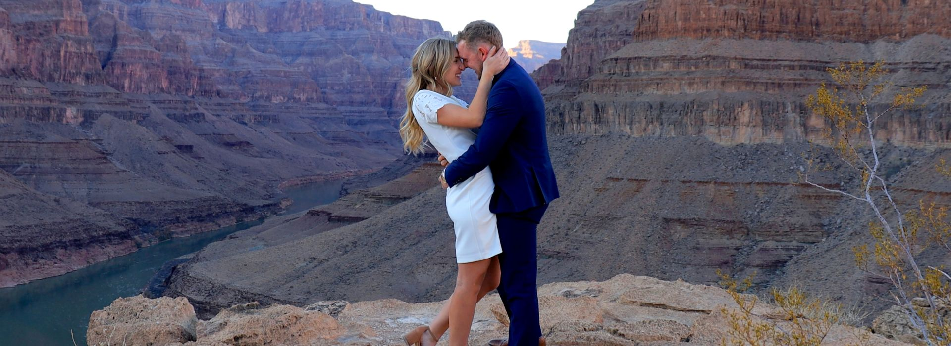 Grand Canyon proposal with red helicopter landed at the bottom of the canyon.