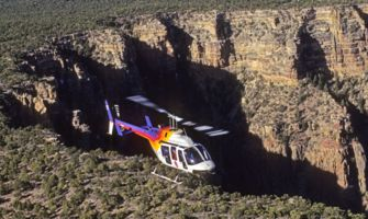 RS13686_RS5604_Bell-Heli_EDIT-rainbow-heli-flying-on-edge-of-forrest-and-grand-canyon-south-rim