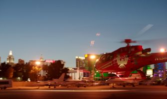 RS7748_Bclip9-red-es130-helicopter-preparing-for-takeoff-at-night-las-vegas-strip