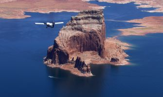 RS8132_5B-new-painted-airplane-flying-over-lake-powell-rock-formations
