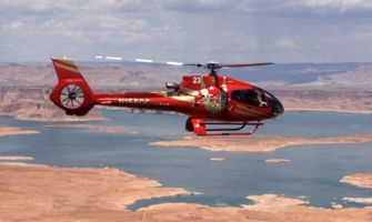RS8151_freeze7-red-ec-130-flying-over-lake-powell-facing-right