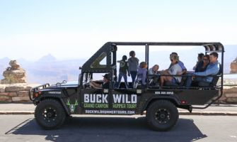 RS9494_IMG_3447-hummer-with-passengers-on-edge-of-grand-canyon-south-rim-sunny-day