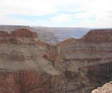 A famous bird-shaped rock formation found at the Grand Canyon West Rim known as Eagle Point.