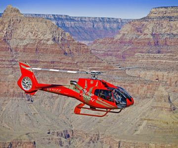 A helicopter tour seen mid-flight over the Grand Canyon.