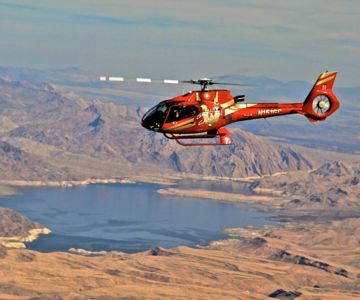 A Grand Canyon helicopter tour flies over the nearby Lake Mead en route to the park.
