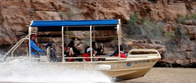 Grand Voyager pontoon boat cruising during Grand Canyon helicopter and boat tour from Las Vegas