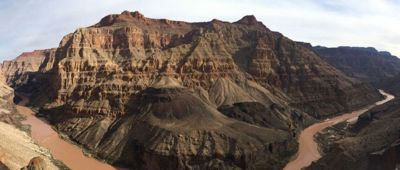 Panorama shot of the Colorado river winding its way through the bottom of Grand Canyon