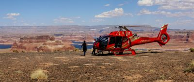 Helicopter landed on top of Tower Butte with Lake Powell in the background