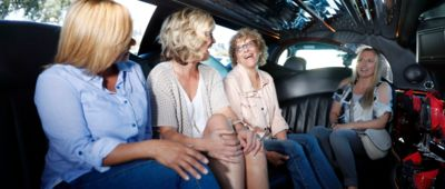 Passengers inside stretch limousine during Papillon's private Grand Canyon helicopter tour from Las Vegas
