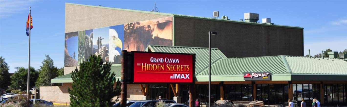 A billboard outside an IMAX theater advertises a Grand Canyon film.