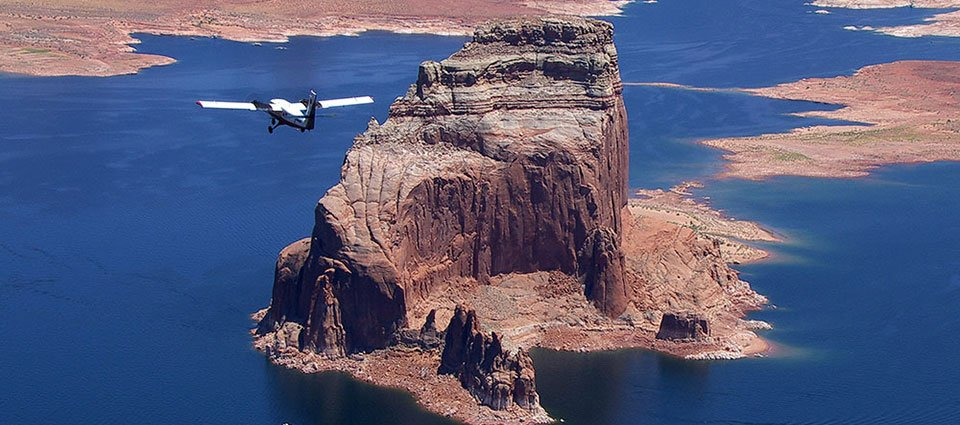Incredible rock formations surrounded by the expanse of Lake Powell.