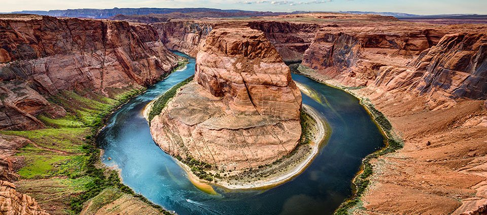 See the elusive Horseshoe Bend in the Colorado River from your aircraft window.
