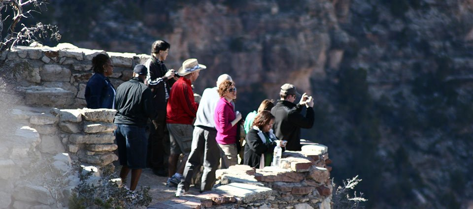 Sightseeing at the edge of Grand Canyon South Rim.