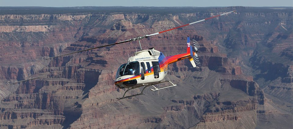 A Grand Canyon helicopter tour taking flight over the national park.