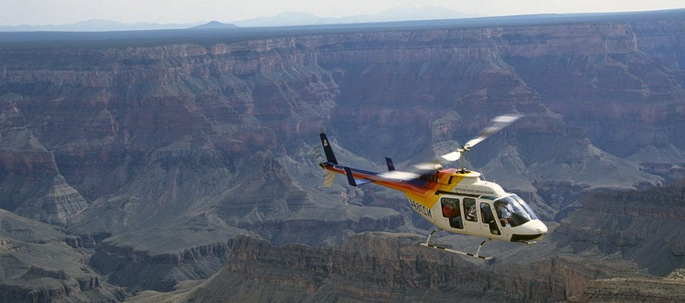 A sightseeing helicopter tour soaring over the South Rim.