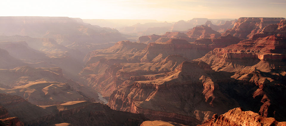 The sun setting across the Grand Canyon National Park.